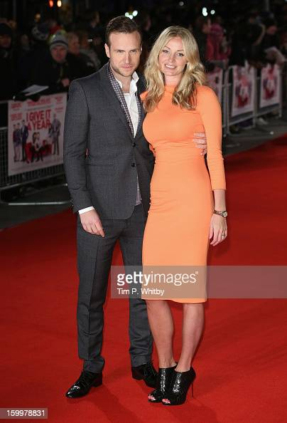 Actor Rafe Spall with his wife Elize Du Toit attend the UK Premiere of 'I Give It A Year' at the Vue West End on January 24 2013 in London England