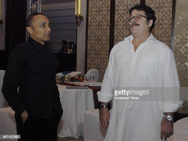Actor Rahul Bose chatting with Shashi Kapoor's son Kunal Kapoor during the second edition of HT for Mumbai Awards on January 10 2015 in Mumbai India