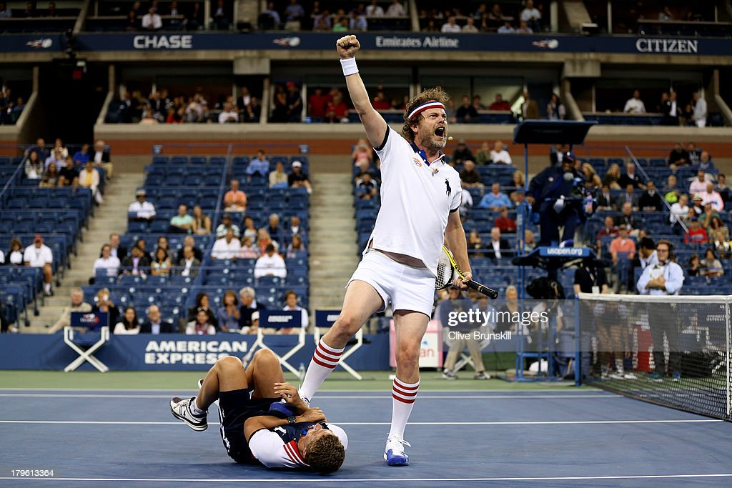 Actor <a gi-track='captionPersonalityLinkClicked' href=/galleries/search?phrase=Rainn+Wilson&family=editorial&specificpeople=534993 ng-click='$event.stopPropagation()'>Rainn Wilson</a> steps on a ballboy after wrestling him to the ground during the exhibition doubles match against Chris Evert and Monica Seles of the United States of America on Day Eleven of the 2013 US Open at USTA Billie Jean King National Tennis Center on September 5, 2013 in the Flushing neighborhood of the Queens borough of New York City.
