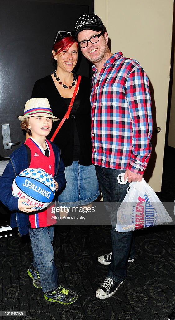 Actor Rainn Wilson, wife Holiday Reinhorn and son Walter Mckenzie Wilson attend the Harlem Globetrotters 'You Write The Rules' 2013 tour game at Staples Center on February 17, 2013 in Los Angeles, California.