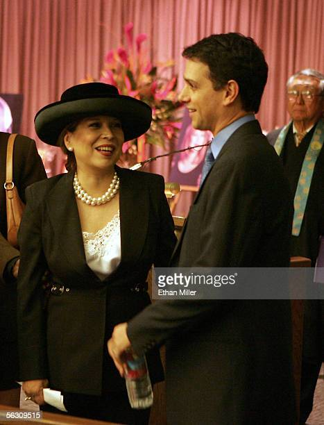 Actor Ralph Macchio talks with Pat Morita's widow Evelyn Guerrero before a memorial service for Morita his costar in the movie 'The Karate Kid' at...