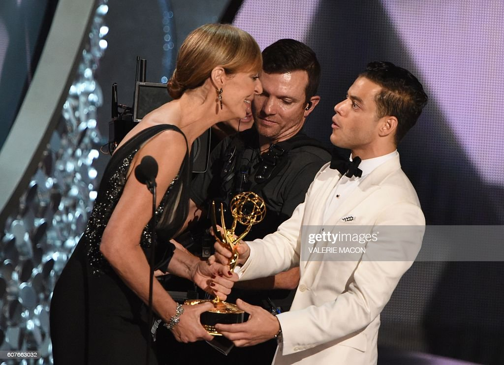Actor Rami Malek accepts the Emmy for Outstanding Lead Actor in a Drama Series from actress Allison Janney during the 68th Emmy Awards show on September 18, 2016 at the Microsoft Theatre in Los Angeles. / AFP / Valerie MACON