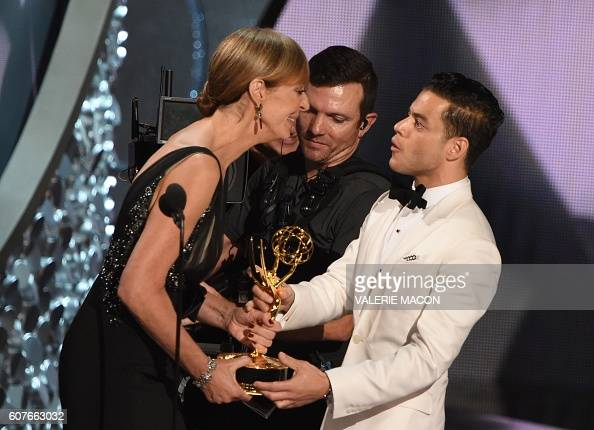 Actor Rami Malek accepts the Emmy for Outstanding Lead Actor in a Drama Series from actress Allison Janney during the 68th Emmy Awards show on...