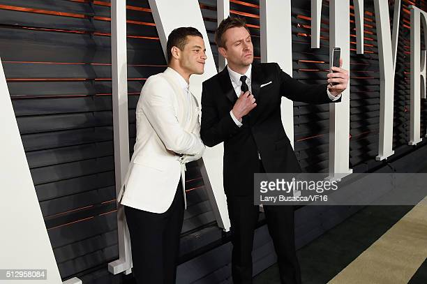 Actor Rami Malek and TV/Internet personality Chris Hardwick pose for a selfie photo at the 2016 Vanity Fair Oscar Party Hosted By Graydon Carter at...