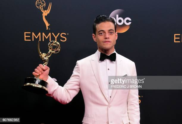 TOPSHOT Actor Rami Malek poses with the Emmy for Outstanding Lead Actor in a Drama Series in the press room during the 68th Emmy Awards on September...
