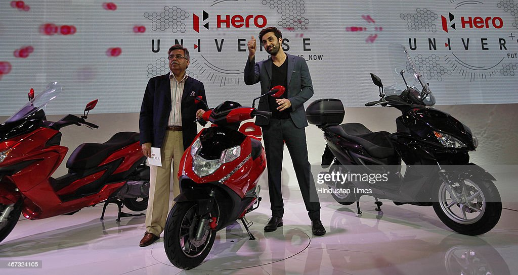 Actor Ranbir Kapoor with Pawan Munjal, the Managing Director and CEO of Hero MotoCorp during the launch of two powerful and sleek looking scooters - the 150cc ZIR range, and the aggressively styled 125cc Dare at Hero Pavilion during the 12th Auto-Expo 2014 at India Expo Mart on February 6, 2014 in Greater Noida, India.