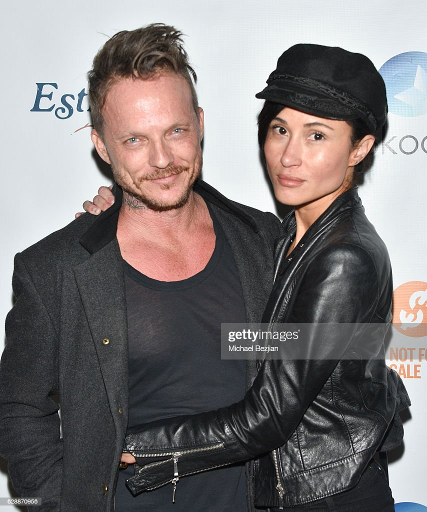 Actor Randall Slavin (L) and Anaka Lee arrive at Not For Sale x Z Shoes Benefit at Estrella Sunset on December 9, 2016 in West Hollywood, California.