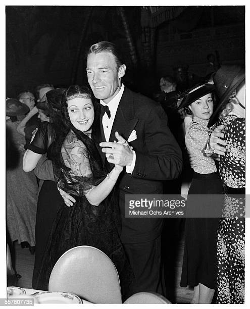 Actor Randolph Scott dances with actress Dorothy Lamour at an event in Los Angeles California