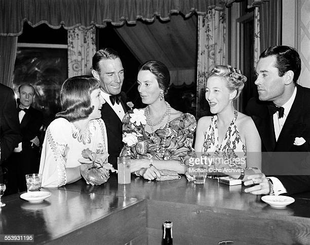 Actor Randolph Scott Henry Fonda and his wife Frances Ford Seymour attend an event in Los Angeles California
