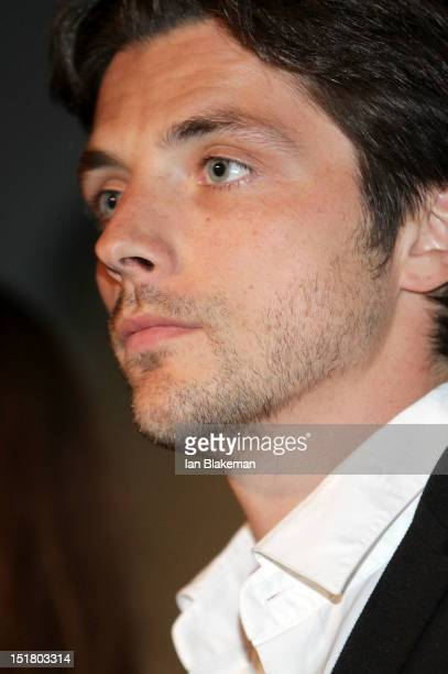 Actor Raphael Personnaz on stage at the 'Three Worlds' Premiere during the 2012 Toronto International Film Festival at the Scotiabank Theatre on...