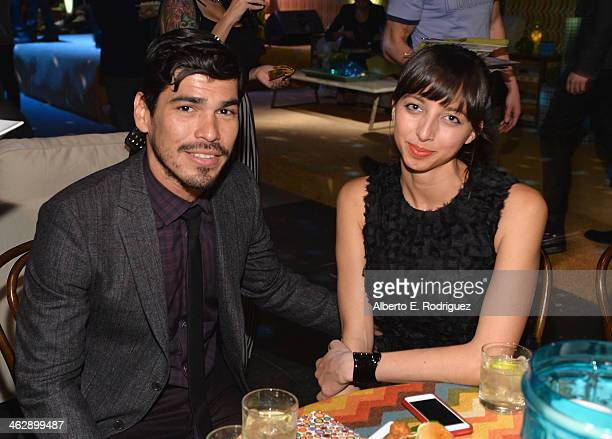 Actor Raul Castillo and guest attend the after party for the premiere of HBO's 'Looking' at Paramount Studios on January 15 2014 in Hollywood...