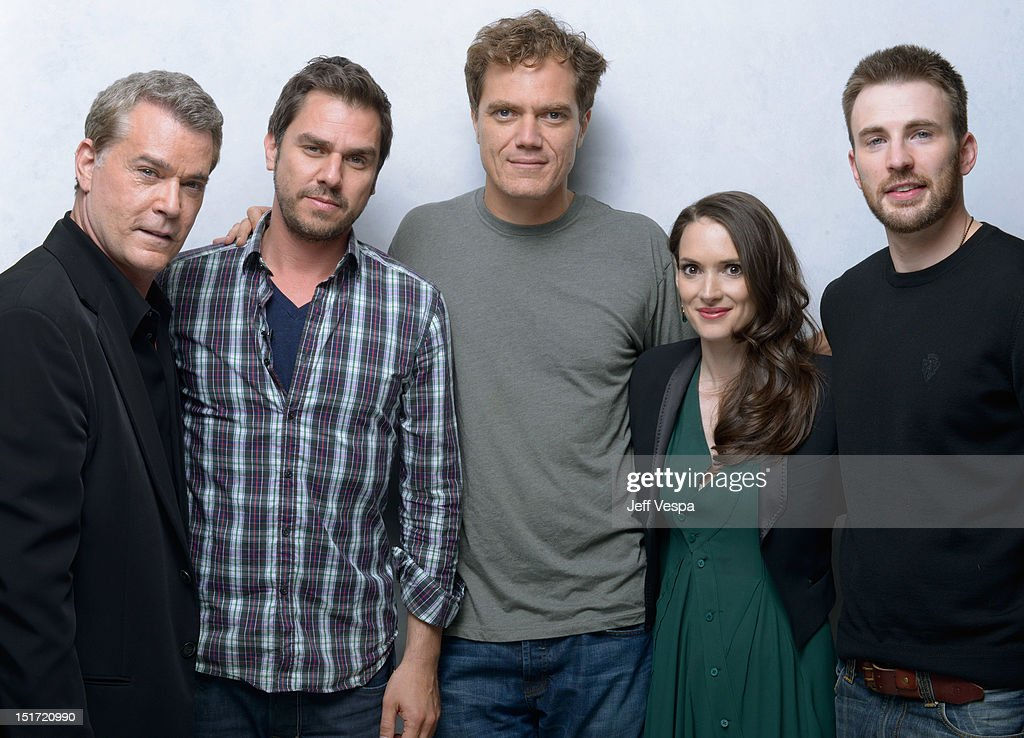 Actor Ray Liotta writer/director/producer Ariel Vromen actors Michael Shannon Winona Ryder and Chris Evans of 'The Iceman' pose at the Guess Portrait...