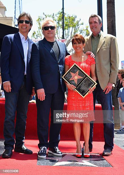 Actor Ray Romano producer David Hunt actors Patricia Heaton and Neil Flynn attend a ceremony honoring Patricia Heaton with the 2472nd star on the...