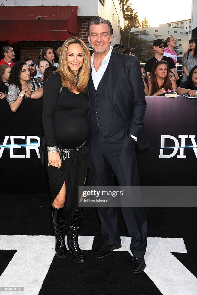 Actor Ray Stevenson and Elisabetta Caraccia arrive at the Los Angeles premiere of 'Divergent' at Regency Bruin Theatre on March 18 2014 in Los...