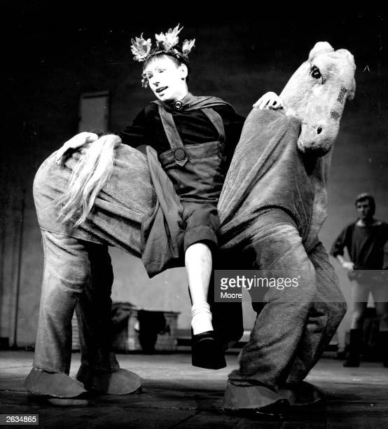 Actor Raymond Platt riding a pantomime horse during rehearsals of a RADA student production of 'Ever Since Aeschuylus' at Vanbrugh Theatre