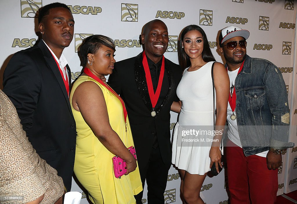 Actor/ recording artist <a gi-track='captionPersonalityLinkClicked' href=/galleries/search?phrase=Tyrese&family=editorial&specificpeople=206177 ng-click='$event.stopPropagation()'>Tyrese</a> Gibson (C) and his guest attend The American Society of Composers, Authors and Publishers (ASCAP) 26th Annual Rhythm & Soul Music Awards at The Beverly Hilton Hotel on June 27, 2013 in Beverly Hills, California.