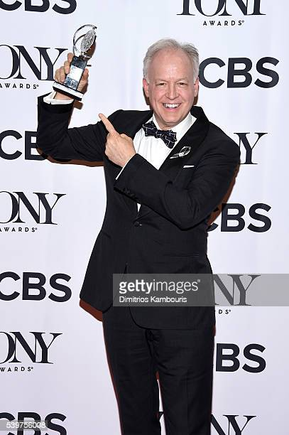 Actor Reed Birney poses in the press room with the award for Best Performance by an Actor in a Featured Role in a Play at the 70th Annual Tony Awards...