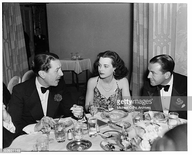 Actor Reginald Gardiner has dinner with actress Hedy Lamarr and actor Richard Barthelmess in Los Angeles California