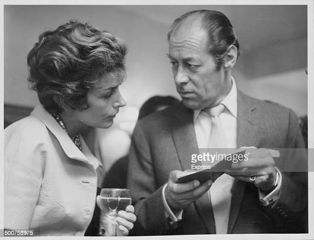 Actor Rex Harrison and his wife Kay Kendall having a discussion at a party in London June 25th 1958