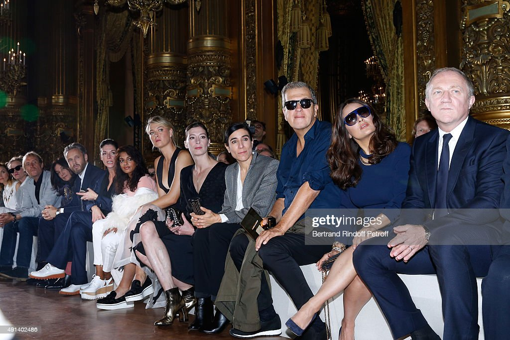 Actor Rhys Ifans, Miss George Harrison, Olivia, Husband of Stella, Alasdhair Willis, Stepsister of Stella, photographe Mary McCartney, Singer Mathangi 'Maya' Arulpragasam alias M.I.A., Tennis Player Maria Sharapova, Star Dancer Marie-Agnes Gillot, Choreographer Blanca Li, Photographer Mario Testino, Actress Salma Hayek and CEO Kering Francois-Henri Pinault attend the Stella McCartney show as part of the Paris Fashion Week Womenswear Spring/Summer 2016. Held at Opera Garnier on October 5, 2015 in Paris, France.