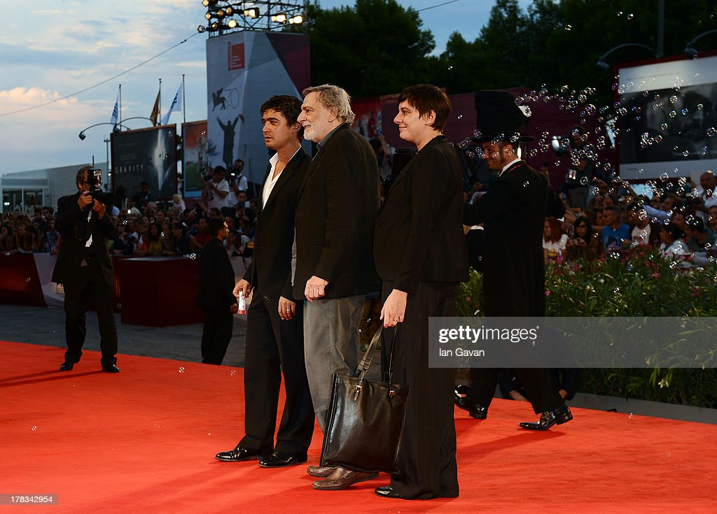 Actor <a gi-track='captionPersonalityLinkClicked' href=/galleries/search?phrase=Riccardo+Scamarcio&family=editorial&specificpeople=816804 ng-click='$event.stopPropagation()'>Riccardo Scamarcio</a>, Founder of Emergency <a gi-track='captionPersonalityLinkClicked' href=/galleries/search?phrase=Gino+Strada&family=editorial&specificpeople=4203022 ng-click='$event.stopPropagation()'>Gino Strada</a> and President of Italian medical charity Emergency Cecilia Strada guests of Jaeger-LeCoultre appears on the red carpet for the 'Emergency' charity at the 'Tracks' premiere during the 70th Venice Film Festival at the Palazzo del Cinema on August 29, 2013 in Venice, Italy.