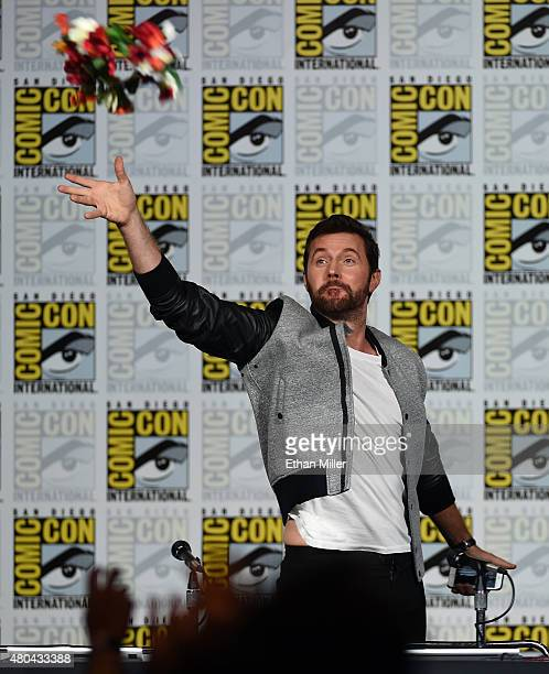 Actor Richard Armitage throws a flower crown to fans at the 'Hannibal' Savor the Hunt panel during ComicCon International 2015 at the San Diego...