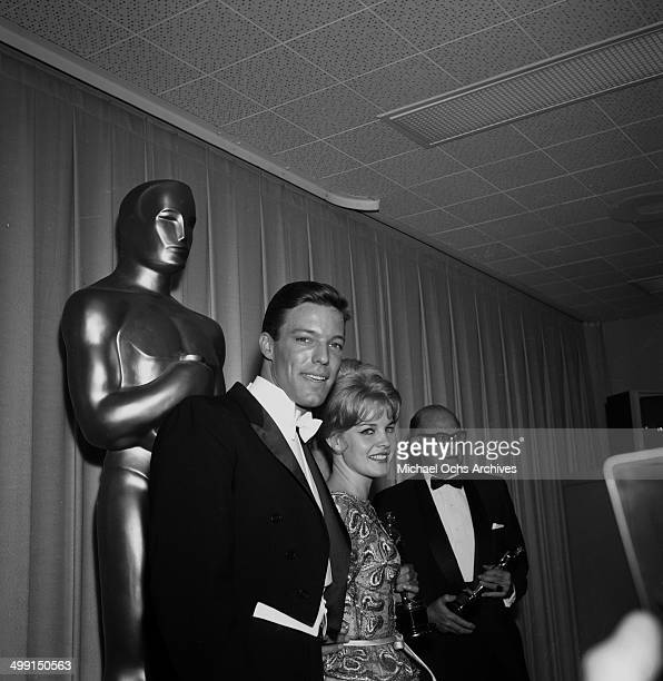 Actor Richard Chamberlain poses with an actress at the Academy Awards in Los Angeles California