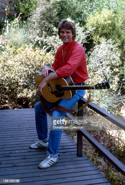Actor Richard Dean Anderson best known for his role as TV's MacGyver poses holding an acoustic guitar during a portrait session at his home in...
