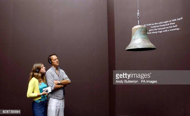 Actor Richard E Grant and his daughter Olivia look at the bell struck by lookout Frederick Fleet when he saw the iceberg that sunk the Titanic during...