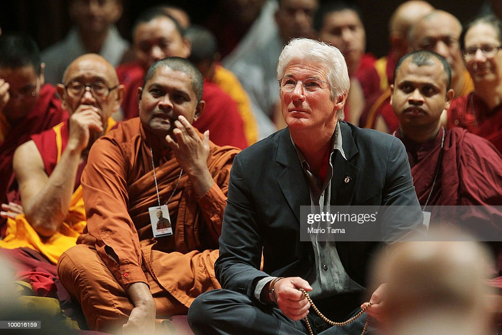 Actor Richard Gere (C) and Buddhist monks watch as the Dalai Lama delivers a teaching at Radio City Music Hall May 20, 2010 in New York City. The Tibetan spiritual leader will deliver three days of teachings at Radio City followed by an interfaith dialogue at the Church of St. John the Divine on Sunday.