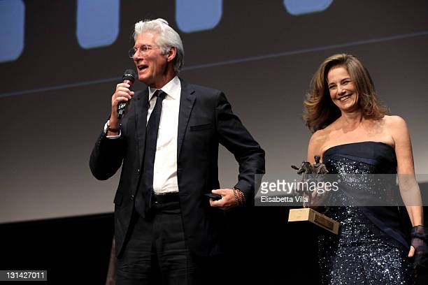 Actor Richard Gere as he accepts his Marc' Aurelio award for Lifetime Achievement and Jury member Debra Winger during the Closing Ceremony of the 6th...