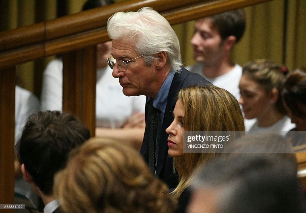 US actor Richard Gere attends a meeting of Pope Francis with the participants of the Sixth World Congress of Pontifical Foundation Scholas, on May 29, 2016 in Vatican. Scholas is an international organization of pontifical right approved and created by Pope Francis in Vatican City August 13, 2013. It combines technology with art and sport to promote social integration and culture of encounter for peace. / AFP / VINCENZO