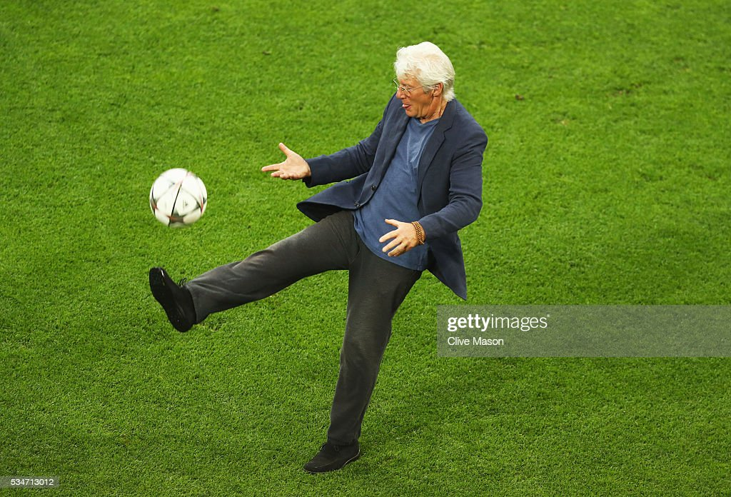 Actor <a gi-track='captionPersonalityLinkClicked' href=/galleries/search?phrase=Richard+Gere&family=editorial&specificpeople=202110 ng-click='$event.stopPropagation()'>Richard Gere</a> kicks the ball on the San Siro pitch after a Real Madrid training session on the eve of the UEFA Champions League Final against Atletico de Madrid at Stadio Giuseppe Meazza on May 27, 2016 in Milan, Italy.