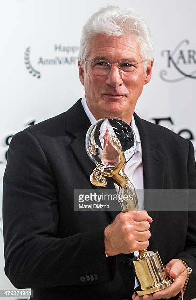 Actor Richard Gere poses with the Crystal Globe for Outstanding Artistic Contribution to World Cinema at the opening ceremony of the 50th Karlovy...