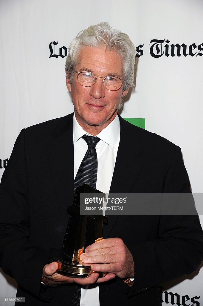 Actor <a gi-track='captionPersonalityLinkClicked' href=/galleries/search?phrase=Richard+Gere&family=editorial&specificpeople=202110 ng-click='$event.stopPropagation()'>Richard Gere</a> poses with the Hollywood Career Achievement Award during the 16th Annual Hollywood Film Awards Gala presented by The Los Angeles Times held at The Beverly Hilton Hotel on October 22, 2012 in Beverly Hills, California.