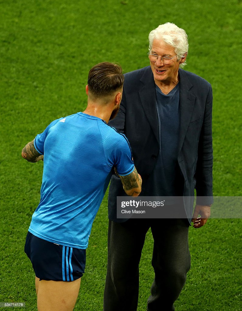 Actor <a gi-track='captionPersonalityLinkClicked' href=/galleries/search?phrase=Richard+Gere&family=editorial&specificpeople=202110 ng-click='$event.stopPropagation()'>Richard Gere</a> shakes hands with Sergio Ramos of Real Madrid after the Real Madrid training session on the eve of the UEFA Champions League Final against Atletico de Madrid at Stadio Giuseppe Meazza on May 27, 2016 in Milan, Italy.