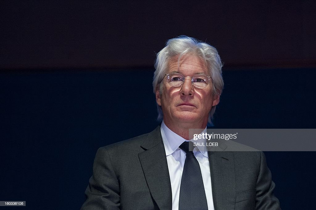 Actor Richard Gere speaks attends a ceremony honoring Chinese activist lawyer Chen Guangcheng with the Tom Lantos Human Rights Prize at the US Capitol in Washington, DC, on January 29, 2013. The prize, awarded annually, honors Guangcheng for his work advocating on behalf of tens of thousands of Chinese fighting for human rights. AFP PHOTO / Saul LOEB