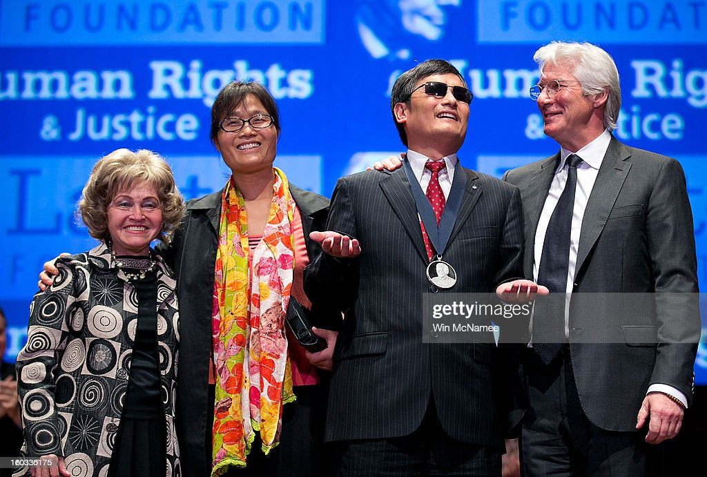 Actor <a gi-track='captionPersonalityLinkClicked' href=/galleries/search?phrase=Richard+Gere&family=editorial&specificpeople=202110 ng-click='$event.stopPropagation()'>Richard Gere</a> (R) stands with Chinese human rights activist Chen Guangcheng (2nd R) after Chen was awarded the 2012 Tom Lantos Human Rights Prize as Lantos' widow Annette Lantos (L) and Chen Guangcheng's wife, Yuan Weijing (2nd L) look on Capitol Hill in Washington, on Tuesday, Jan. 29, 2013. Also pictured are The Lantos Human Rights Prize is awarded each year and aims to raise awareness regarding human rights violations and the individuals dedicated to fighting them around the world.