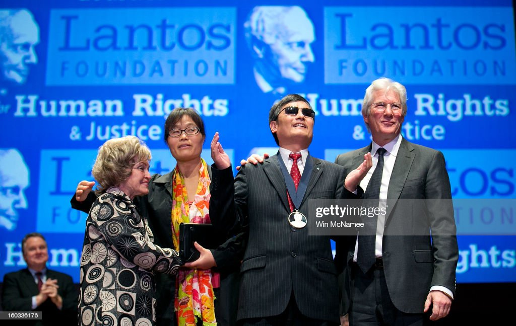 Actor Richard Gere (R) stands with Chinese human rights activist Chen Guangcheng (2nd R) after Chen was awarded the 2012 Tom Lantos Human Rights Prize as Lantos' widow Annette Lantos (L) and Chen Guangcheng's wife, Yuan Weijing (2nd L) look on Capitol Hill in Washington, on Tuesday, Jan. 29, 2013. Also pictured are The Lantos Human Rights Prize is awarded each year and aims to raise awareness regarding human rights violations and the individuals dedicated to fighting them around the world.