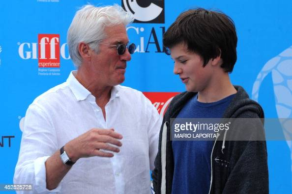 US actor Richard Gere (L) talks to his son Homer during a ...