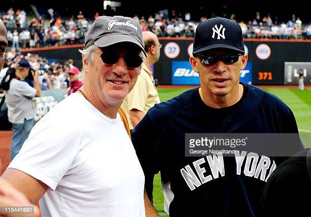 Actor Richard Gere talks with NY Yankees manager Joe Girardi prior to the Subway Series game between the Yankees and the Mets at Citi Field on June...