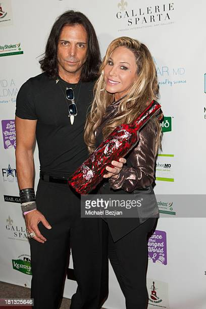 Actor Richard Grieco and television personality Adrienne Maloof attend Mark Kearney Group 'Iced Out' Luxury Emmy Suite Inside Day 1 on September 19...