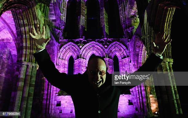 Actor Richard Hollick poses for a picture as he prepares to play Dracula during a performance at the spectacular light display during illuminations...