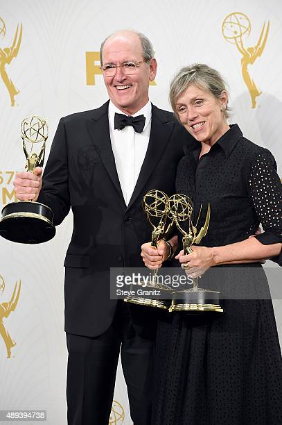 Actor Richard Jenkins and actor/producer Frances McDormand pose with Emmy awards in the press room at the 67th Annual Primetime Emmy Awards at...