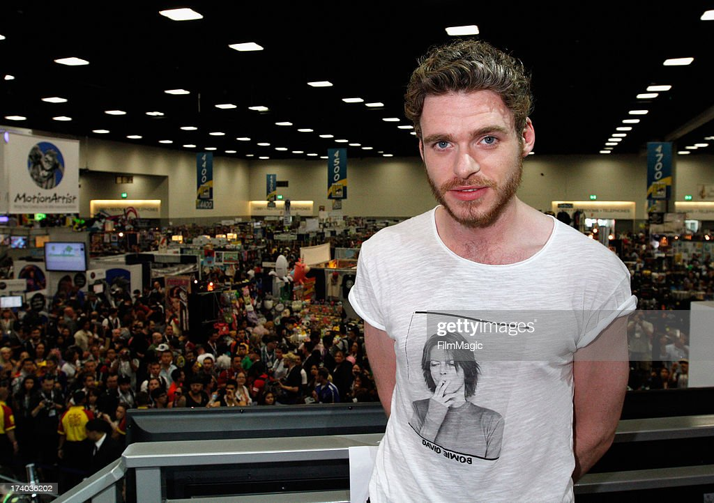 Actor <a gi-track='captionPersonalityLinkClicked' href=/galleries/search?phrase=Richard+Madden&family=editorial&specificpeople=8954998 ng-click='$event.stopPropagation()'>Richard Madden</a> attends HBO's 'Game Of Thrones' cast autograph signing at San Diego Convention Center on July 19, 2013 in San Diego, California.