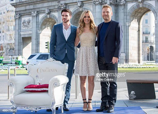 Actor Richard Madden singer Edurne and director Kenneth Branagh attend the 'Cinderella' photocall at Puerta de Alcala on March 16 2015 in Madrid Spain
