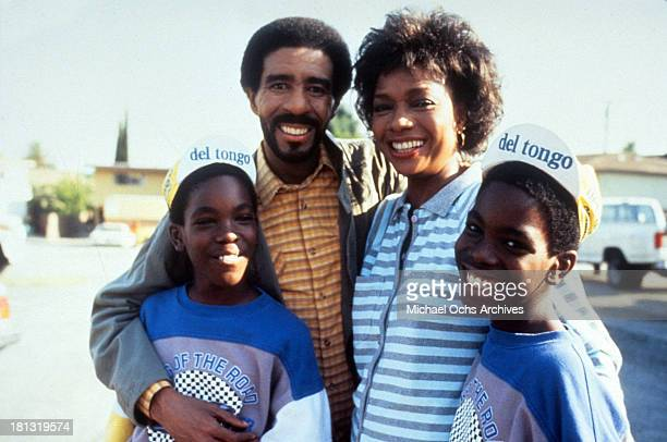 Actor Richard Pryor actress Beverly Todd actors Raphael Harris and Ishmael Harris on set of the Warner Bros movie ' Moving' in 1988