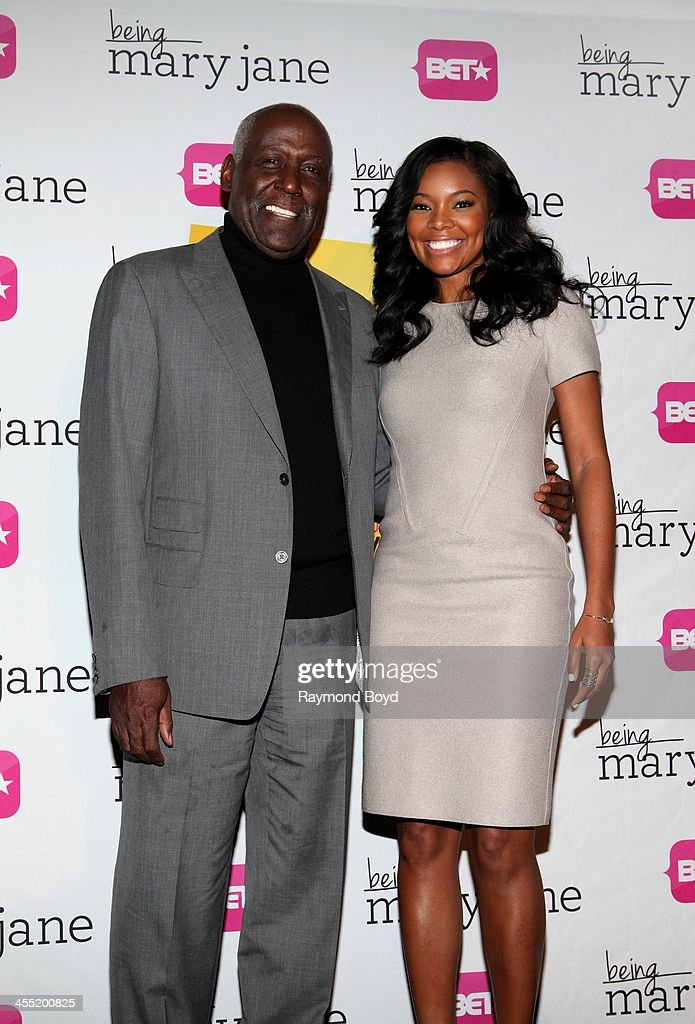 Actor Richard Roundtree and actress Gabrielle Union poses for photos during a luncheon and exclusive advanced screening in celebration of their BET...