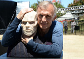 Actor Richard Sammel poses with A wax figure of Quinlan from 'The Strain' at FXhibition during ComicCon International 2016 at Hilton Bayfront on July...