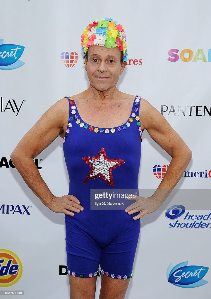 Actor <a gi-track='captionPersonalityLinkClicked' href=/galleries/search?phrase=Richard+Simmons&family=editorial&specificpeople=228501 ng-click='$event.stopPropagation()'>Richard Simmons</a> attends 'Swim for Relief' Benefiting Hurricane Sandy Recovery - Day 2 at Herald Square on October 9, 2013 in New York City.